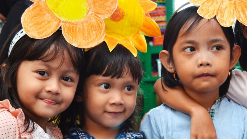 Young children receiving help from the Tanoto Foundation